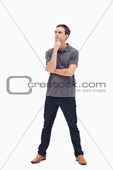 Thoughtful standing man and his legs apart