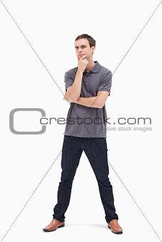 Thoughtful standing man with his legs apart
