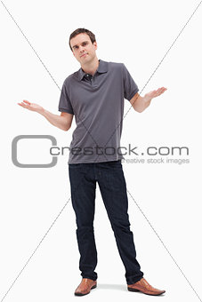 Man shrugging his shoulders