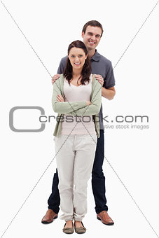 Man holding woman by the shoulders