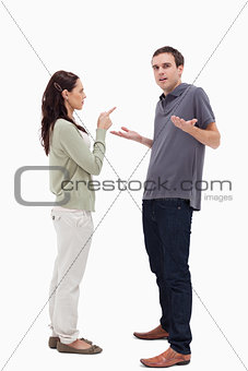 Man shrugged his shoulders is scolded by woman