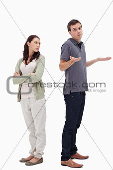 Man shrugged his shoulders back to back with angry woman