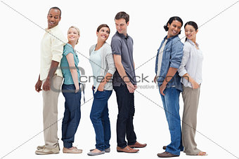 Three couples standing back to back looking at each other