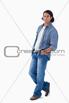 Man leaning against a wall