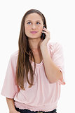 Close-up of a girl listening to a mobile phone