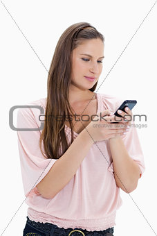 Close-up of a girl typing a text message