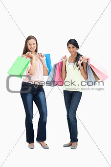 Girls smiling with shopping bags