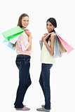 Smiling women carrying a lot of shopping bags