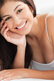 Close up Woman with a hand on her cheek, smiling and looking str