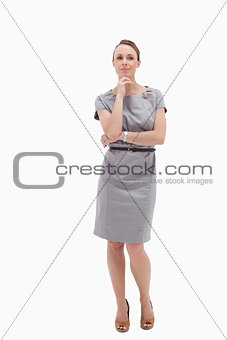 Thoughtful businesswoman posing