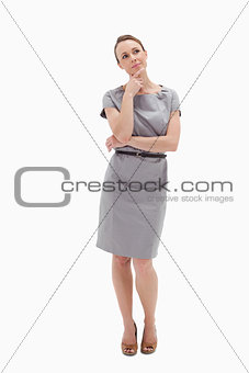 Thoughtful woman posing in dress