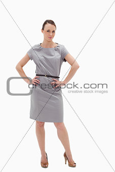 Woman posing in a dress with her hands on her hips