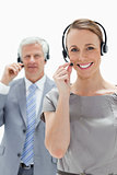Smiling woman wearing a headset with a man