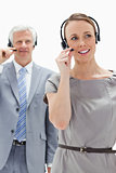 Close-up of a woman wearing a headset with a white hair business