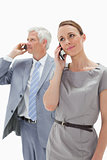 Close-up of a woman making a call with a white hair businessman 