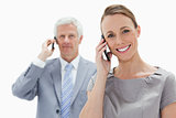 Close-up of a smiling woman making a call with a white hair man 