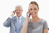 Close-up of a white hair businessman making a call with a smilin