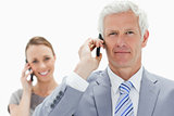 Close-up of a white hair businessman on the phone with a smiling