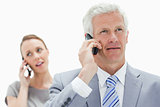 Close-up of a white hair businessman talking on the phone with a