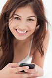 Close up, Smiling woman with her smartphone in hand