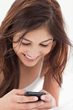 Close up, woman using her smartphone and smiling