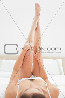 Close up shot focusing on womans legs and arms