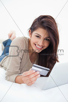 Close up, woman smiling with credit card and tablet in hand, lyi
