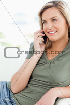Close up, woman making a phone call, smiling and looking to the