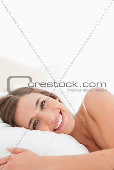 Close up, Woman in bed smiling brightly