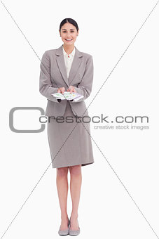 Smiling young businesswoman with bank notes in her hands
