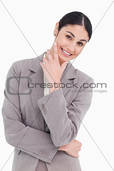 Smiling businesswoman in thinkers pose