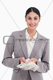 Smiling businesswoman showing her money