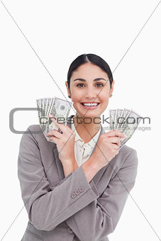Smiling tradeswoman with money in her hands