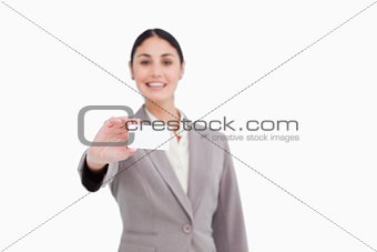 Blank business card being presented by saleswoman