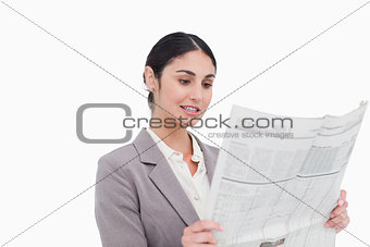 Businesswoman reading news paper