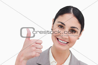 Close up of businesswoman giving thumb up
