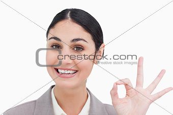 Close up of smiling businesswoman giving her approval