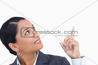 Close up of saleswoman looking and pointing up