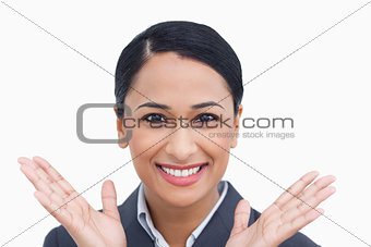 Close up of positive surprised saleswoman