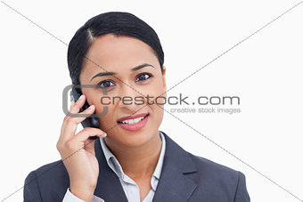 Close up of saleswoman on her cellphone
