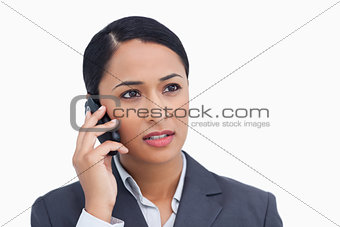 Close up of saleswoman listening to caller