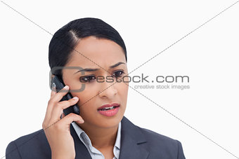 Close up of negative surprised saleswoman on her cellphone