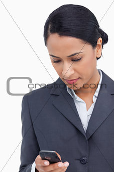 Close up of saleswoman reading text message