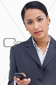 Close up of saleswoman holding cellphone