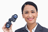 Close up of smiling saleswoman with spy glasses