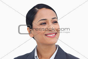 Close up of smiling saleswoman looking to the side