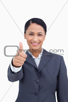 Close up of thumb up being given by smiling saleswoman