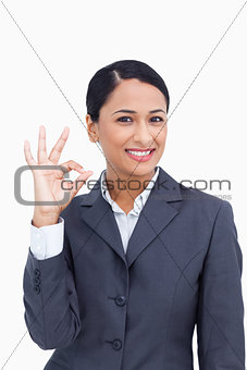Close up of smiling saleswoman giving approval