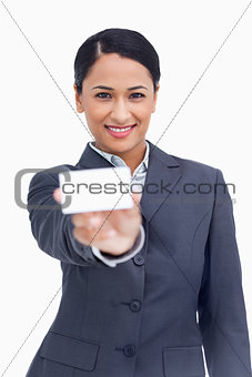 Close up of smiling saleswoman showing her business card
