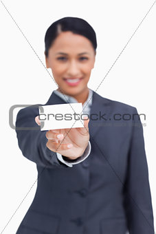 Close up of business card being shown by saleswoman